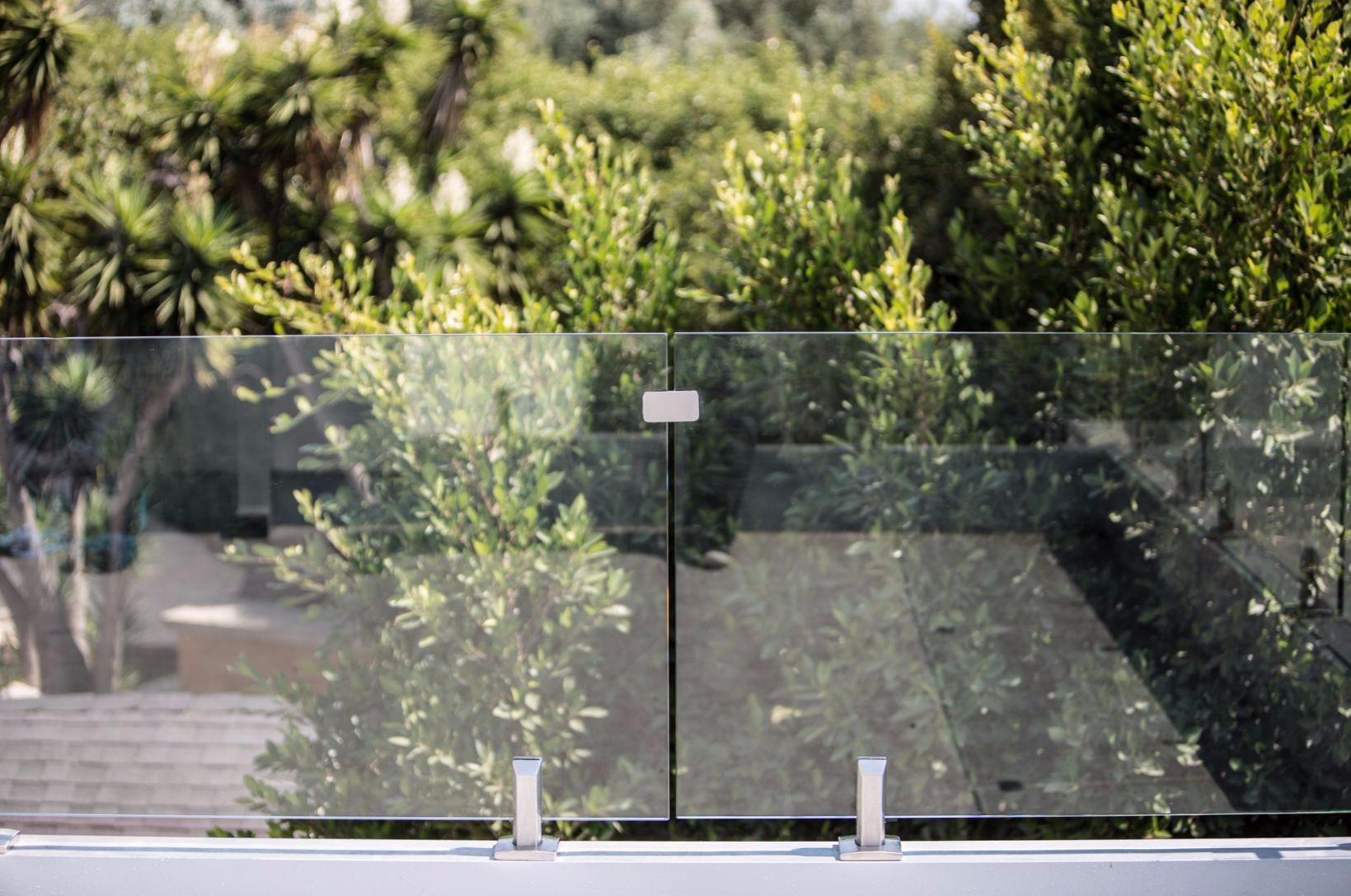 Frameless Glass Fence by Styleguard Systems